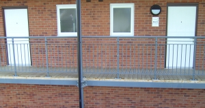 Bradfabs made this balcony access structure, made using mild steel, with timber decking installed on some apartments in Leeds, West Yorkshire