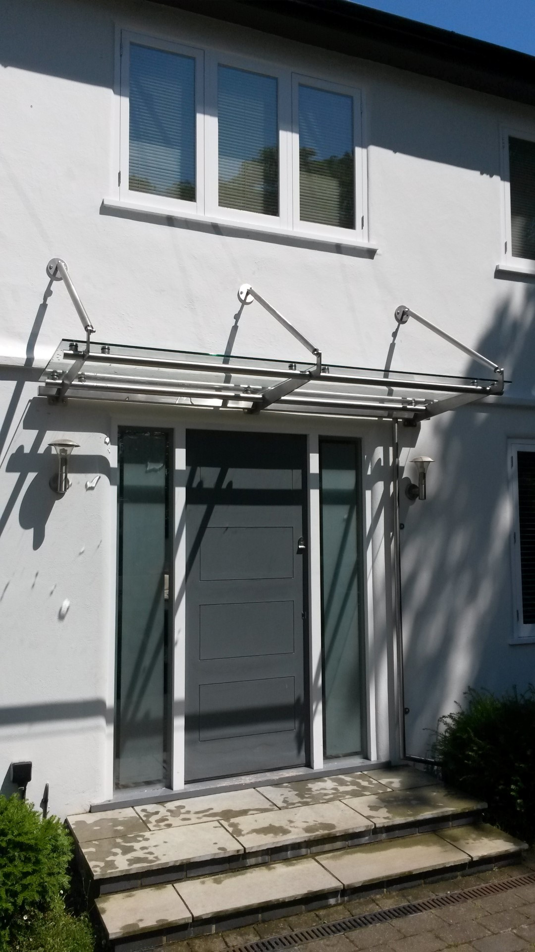 Modern sleek stainless steel and glass canopy