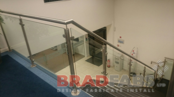 straight staircase with glass balustrade