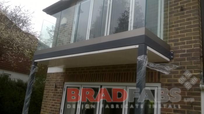 Channel system infinity glass balustrade and mild steel, galvanised and powder coated frame by Bradfabs