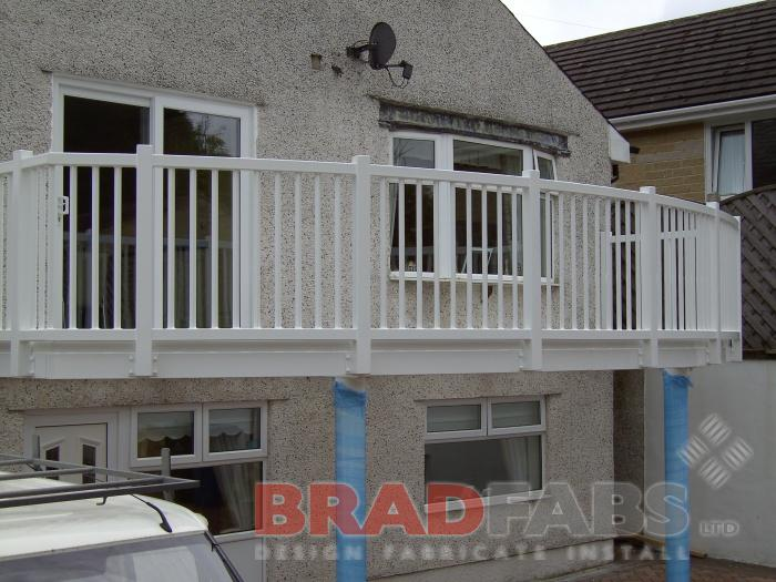 Large mild steel galvanised and powder coated white balcony really makes the wow factor, with two support legs, vertical bar balustrade and complete with composite decked flooring, a professional finish as always by Bradfabs