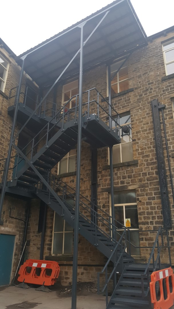 Fire escape with canopy installed and designed by Bradfabs