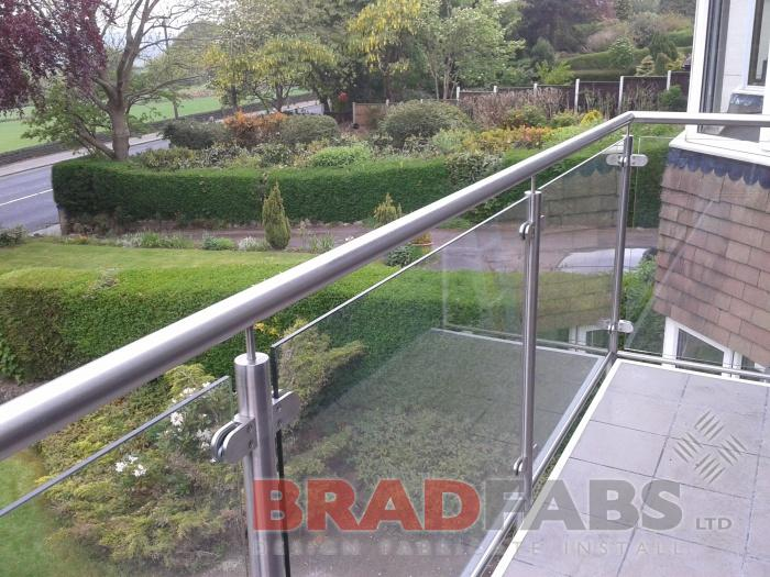 Beautiful floating balcony with stainless steel balustrade and glass infill panels by Bradfabs