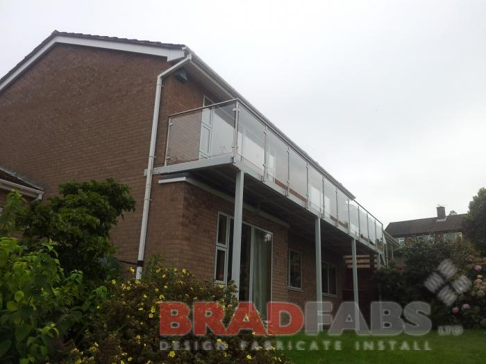 Glass infill panels, mild steel balcony, stainless steel balustrade, bradfabs, bradfabs UK