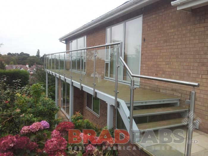 Mild steel balcony, stainless steel balustrade, composite decked flooring, glass infill panels, Bradfabs