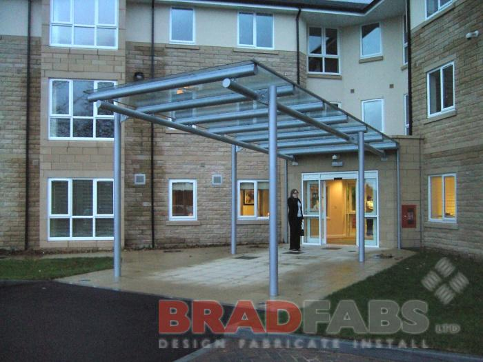 Suspended Canopy, curved Glass Canopy, toughened Glass, weather shelter, stainless Steel Canopy, Canopies in West Yorkshire