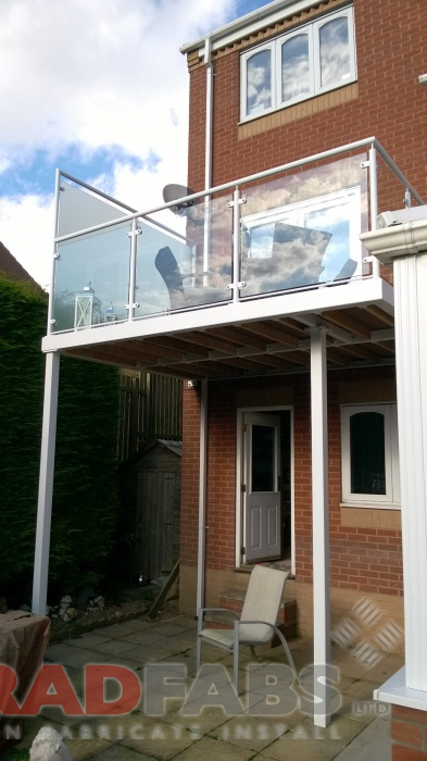 Large balcony with privacy screen to one side and two support legs, mild steel, galvanised and powder coated white by Bradfabs