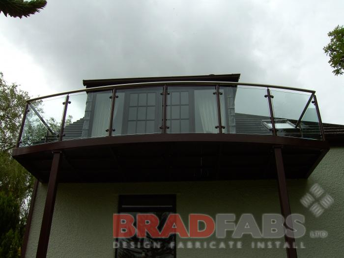 Elevated Balcony made to match existing brown windows