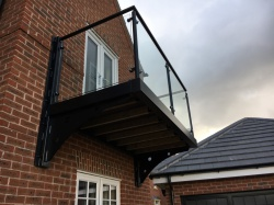 Composite deck floor and tubular balustrade