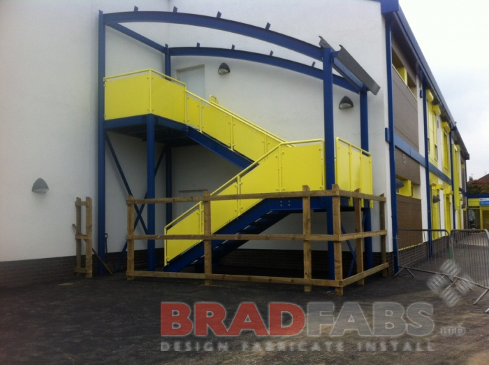 Staircase with Yellow Laser Cut panels and blue treads