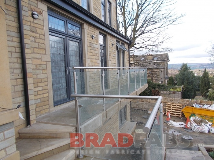 Stainless Steel and Glass Balustrade - Balcony is steel clad in stone.