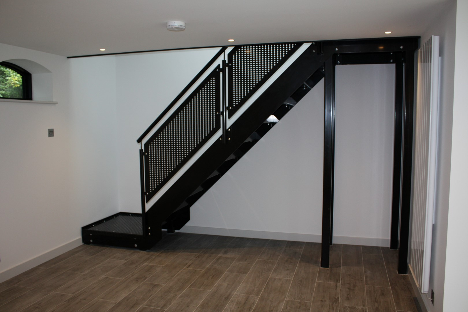 Perforated balustrade staircase