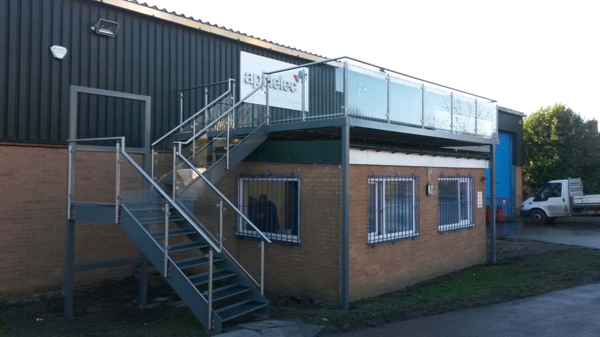 Commercial staircase and balcony designed, manufactured and installed by Bradfabs