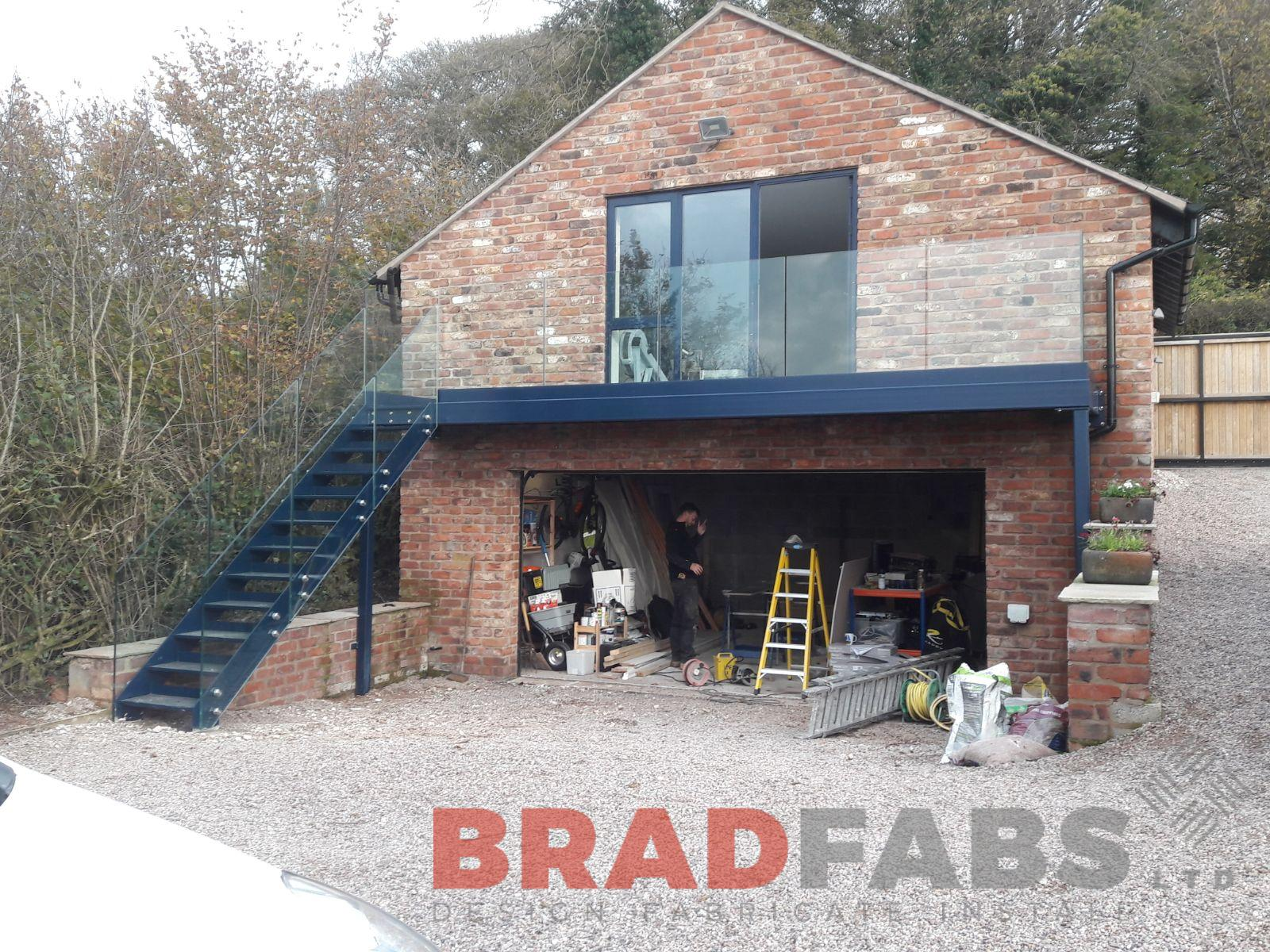 Powder coated, mild steel balcony and staircase with infinity glass