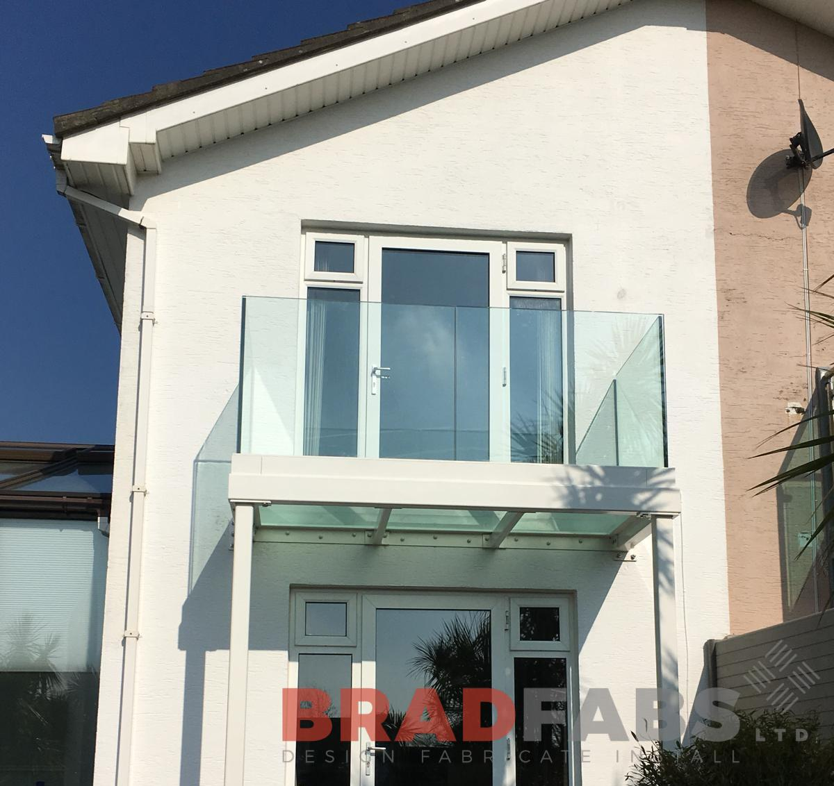 Stunning bespoke balcony with glass floor designed, manufactured and installed by Bradfabs