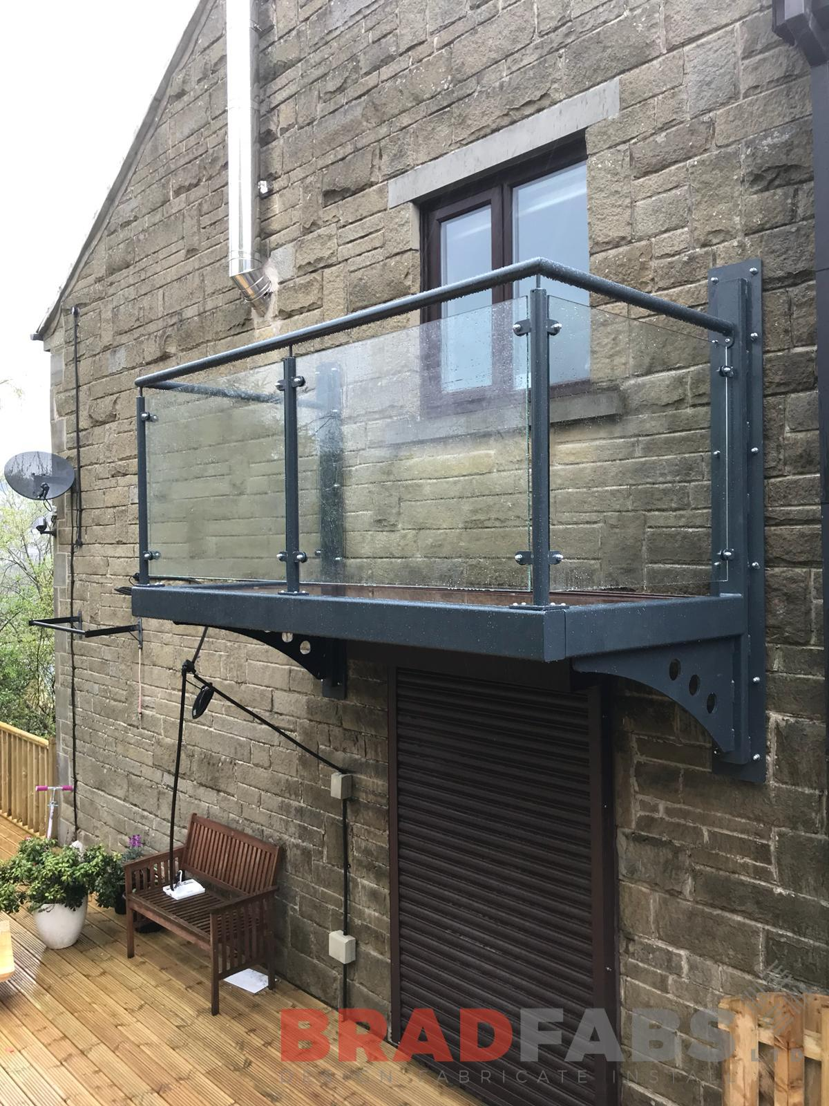 Cantilevered balcony with glass balustrade designed, manufactured and installed by Bradfabs