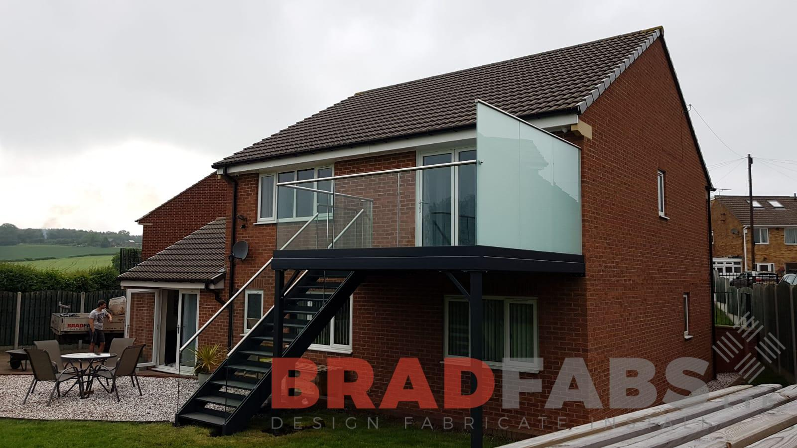 Stunning privacy glass balcony and staircase design, supplied and installed by Bradfabs