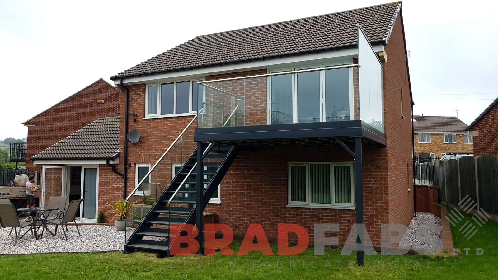 Garden access metal and glass balcony with staircase by Bradfabs