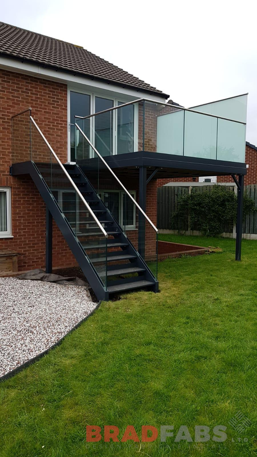 Custom made glass balcony and staircase installed in Yorkshire by Bradfabs