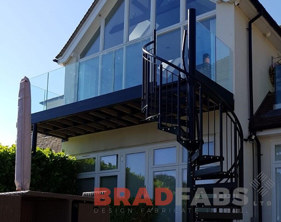 Infinity glass balcony with metal spiral by Bradfabs