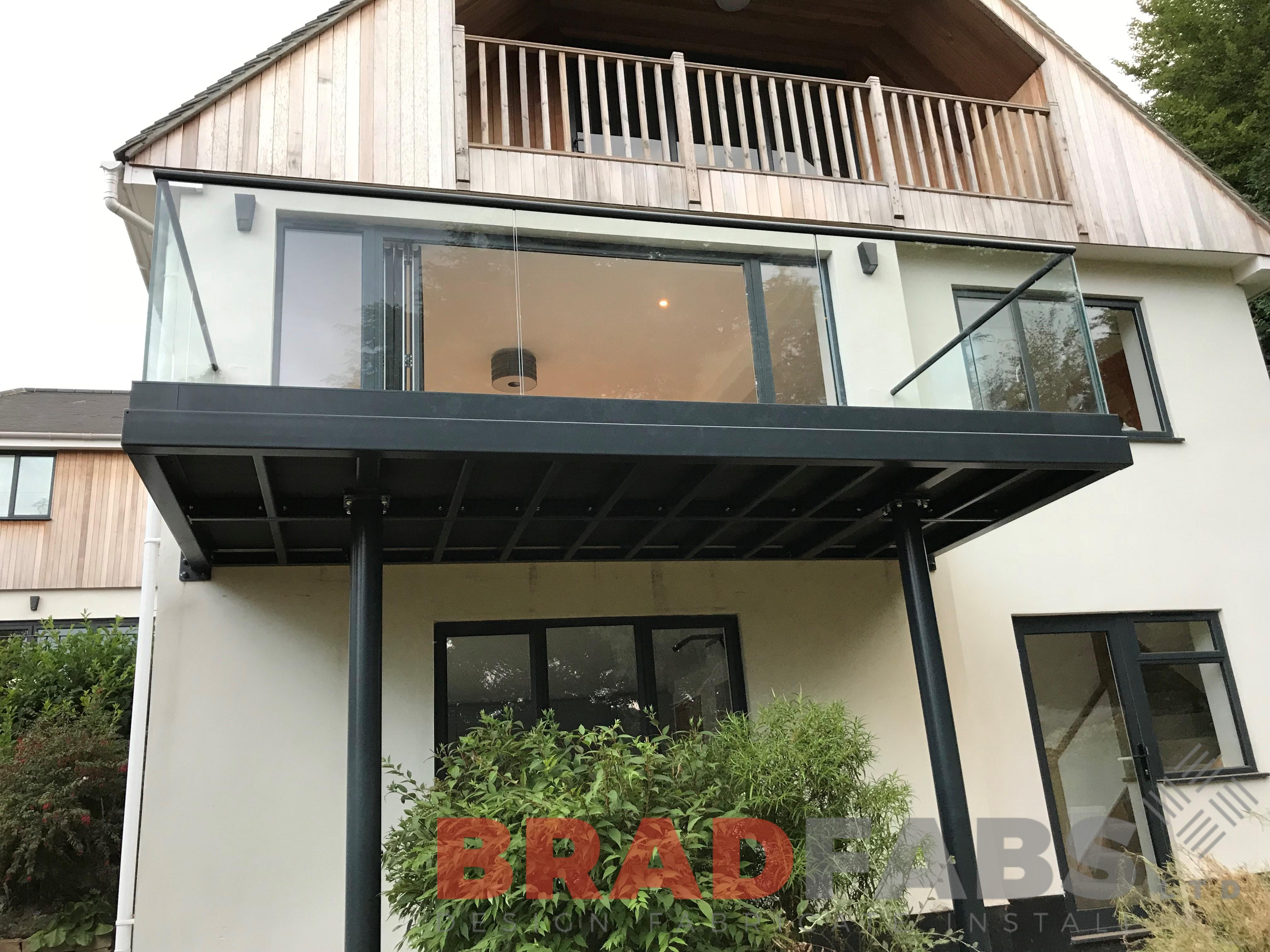 Bespoke designed metal and infinity glass balcony by Bradfabs