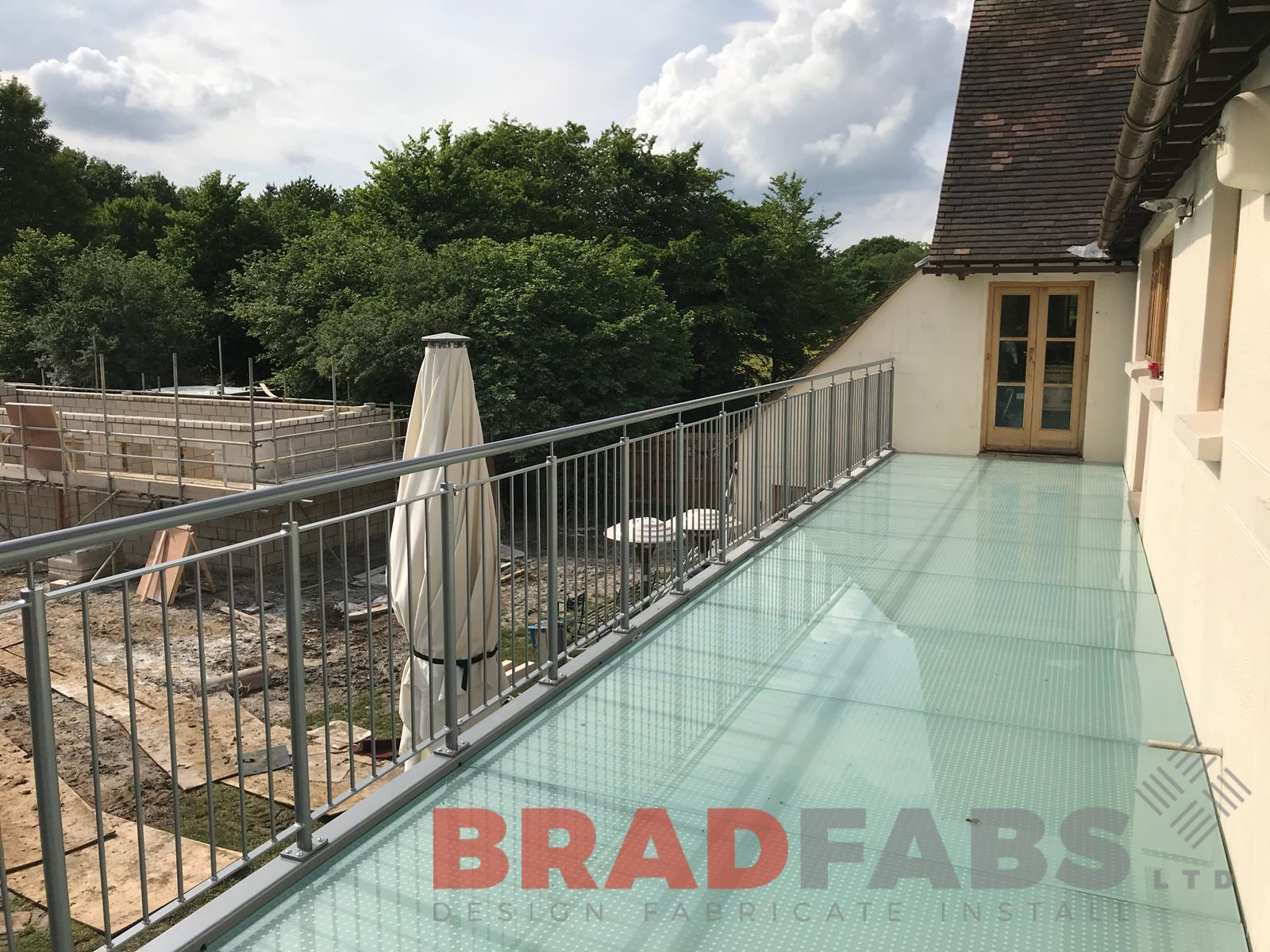 Glass floor on balcony with vertical bar balustrade