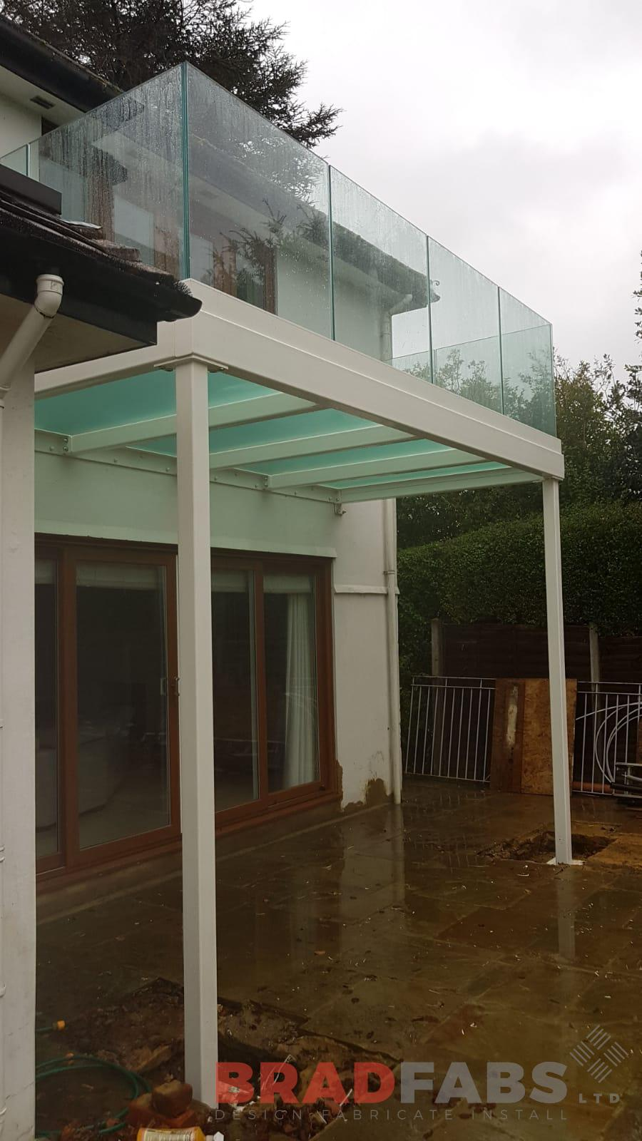 Beautiful modern balcony with glass floor and infinity glass balustrade, mild steel, galvanised and powder coated white