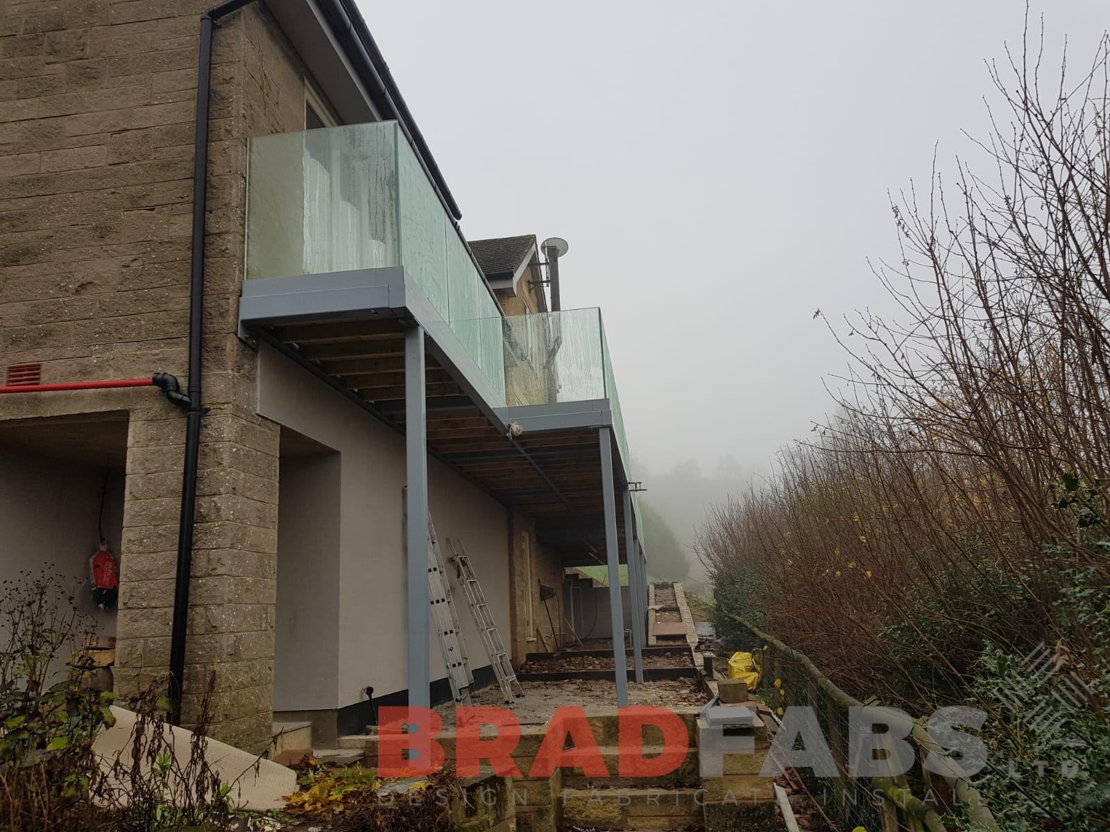Glass and metal balcony installed and manufactured by Bradfabs