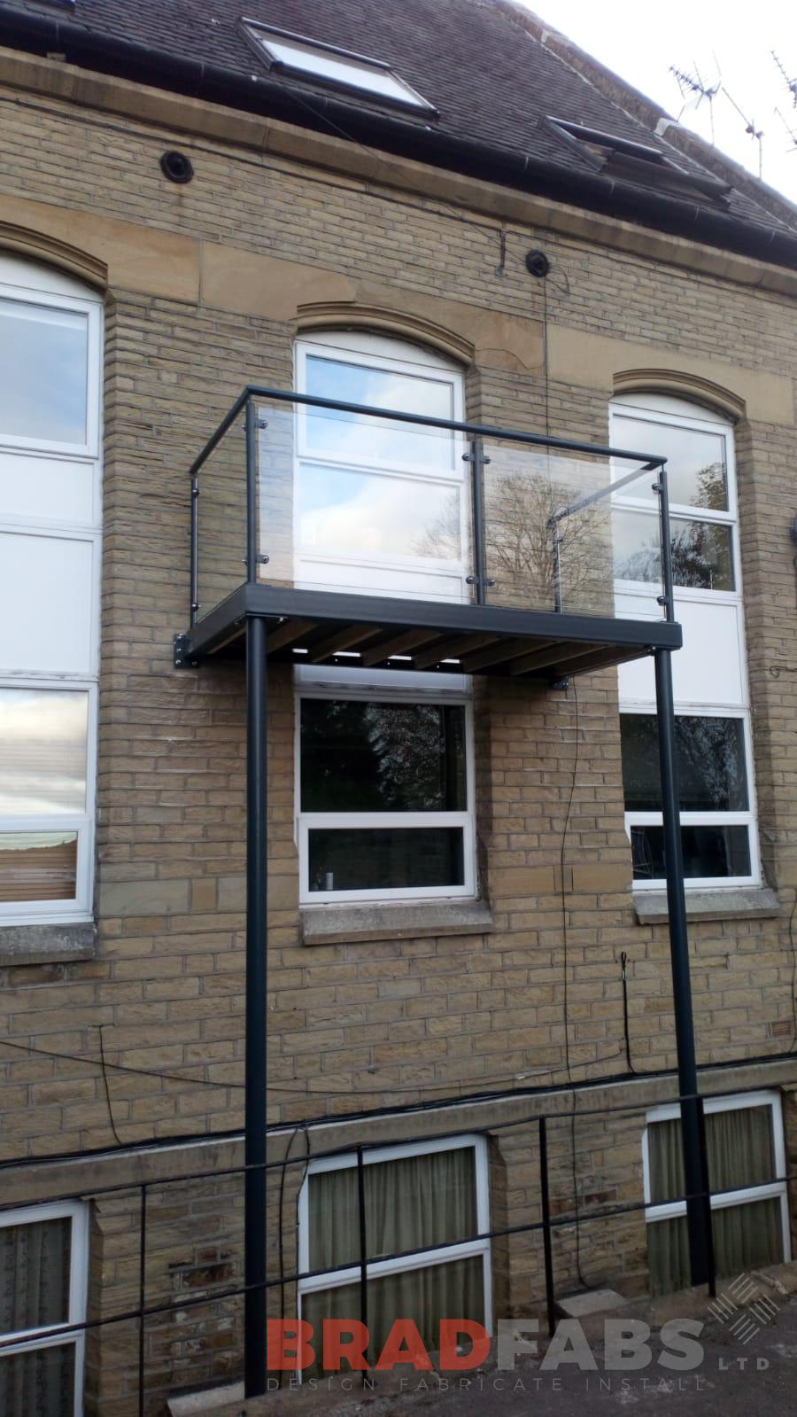 Balcony, Mild steel, galvanised, powder coated, balcony with legs, composite decked floor, glass balustrade