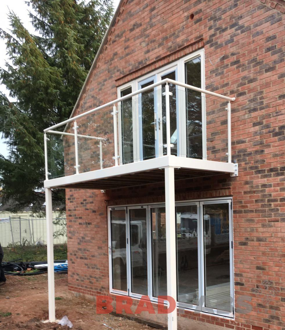 Bradfabs, Mild steel balcony, balcony with legs, powder coated, galvanised balcony, glass infill panels