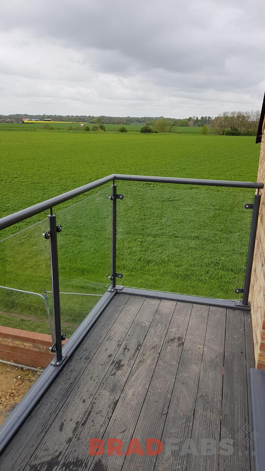 A view of our customers excellent finish of composite decked flooring and 10mm toughened safety glass, with mild steel galvanised and powder coated frame by Bradfabs
