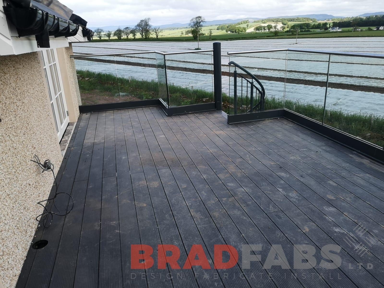 Our customers composite decked flooring and infinity glass balustrade and stainless steel handrail ready to over look their amazing views by Bradfabs