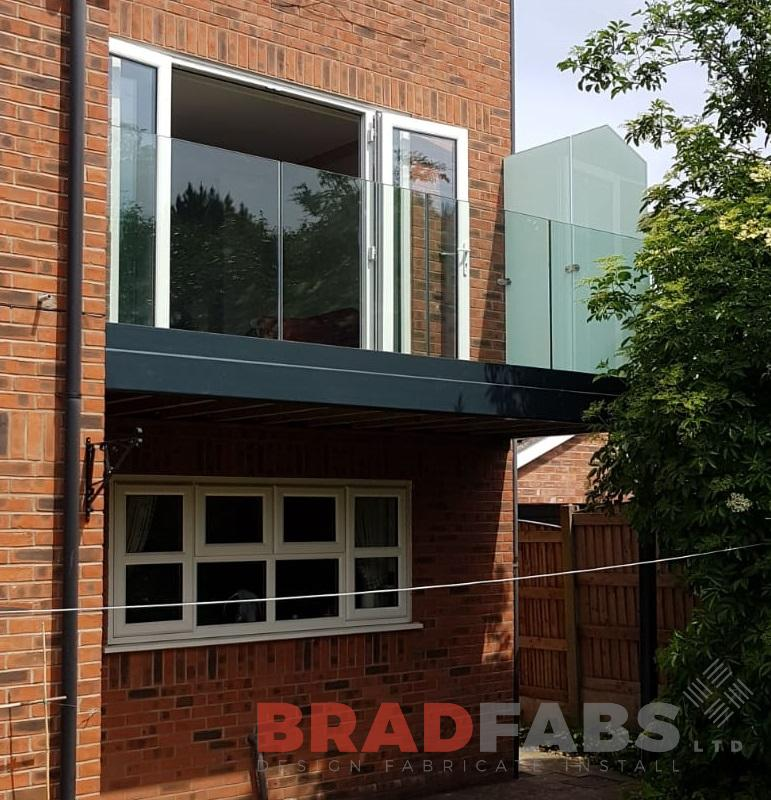 Beautiful home addition, mild steel, galvanised and powder coated balcony with infinity glass balustrade and privacy screen to one side by Bradfabs