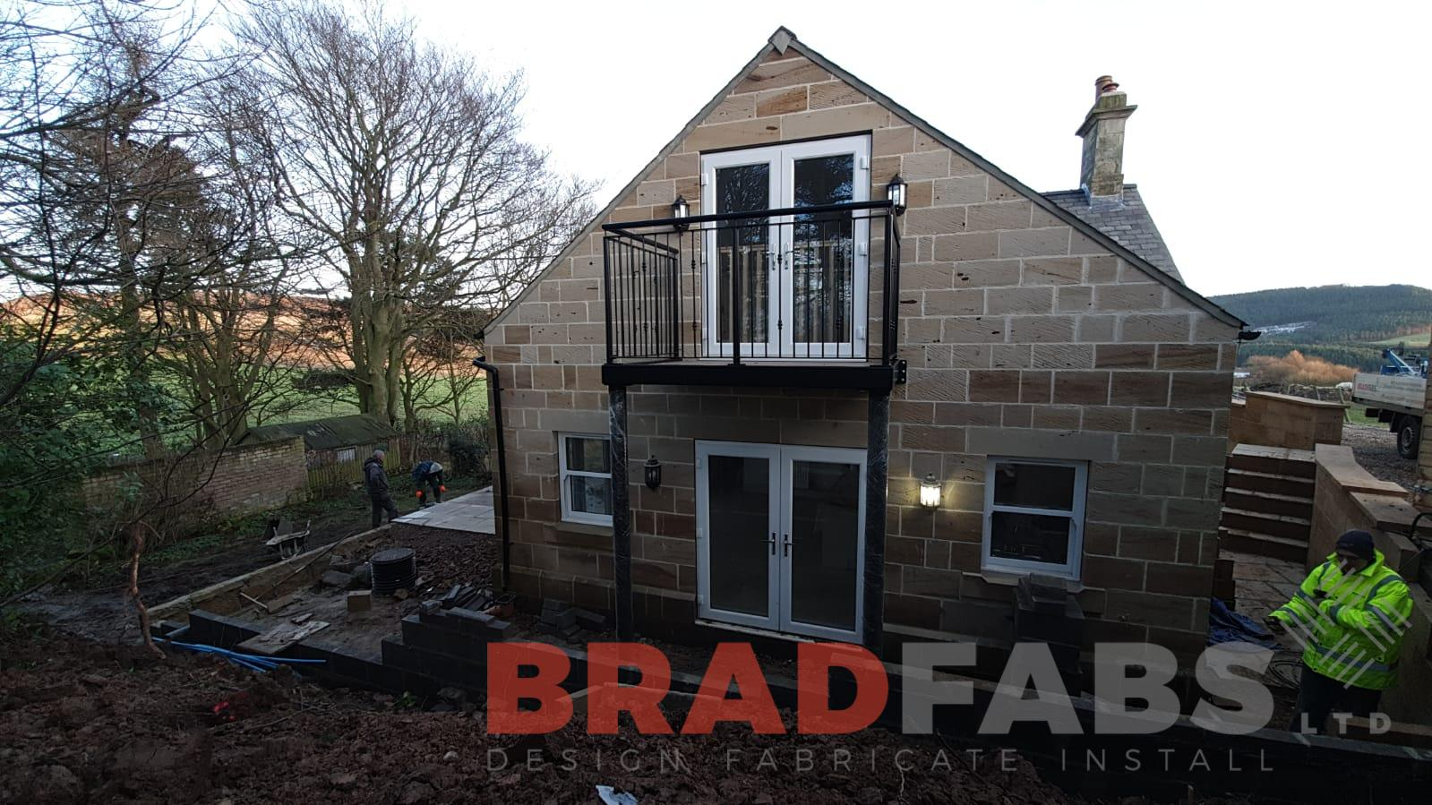 Bradfabs ltd, balcony with supporting legs, vertical decorative balustrade, bespoke balcony, mild steel, galvanised and powder coated black, composite decked flooring