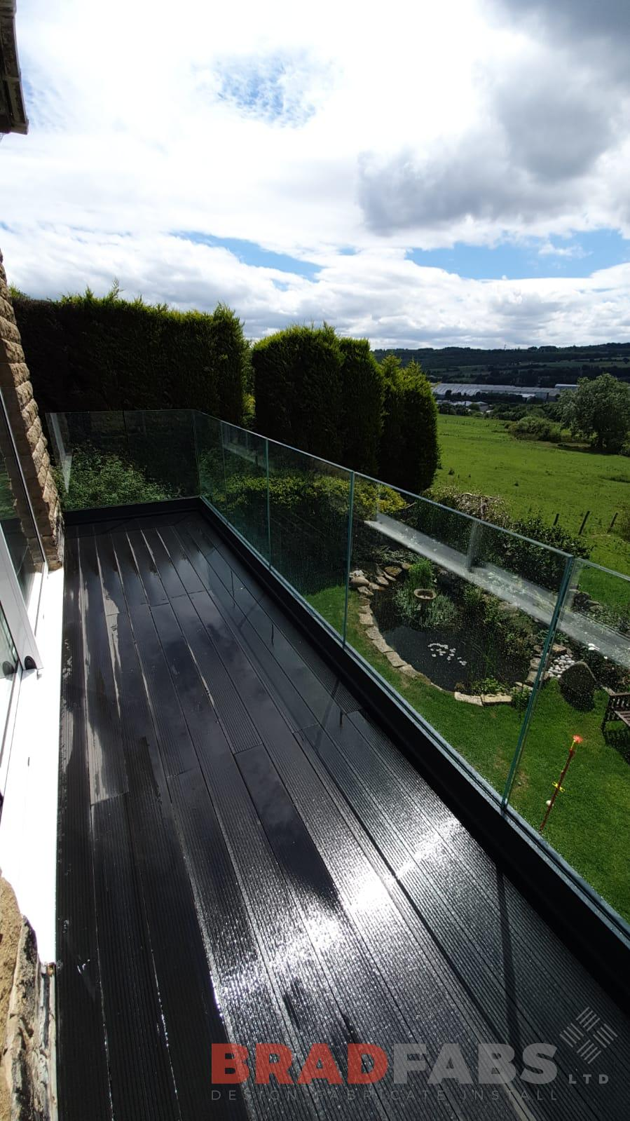 Bespoke balcony with one supporting leg and channel system infinity glass by Bradfabs Ltd