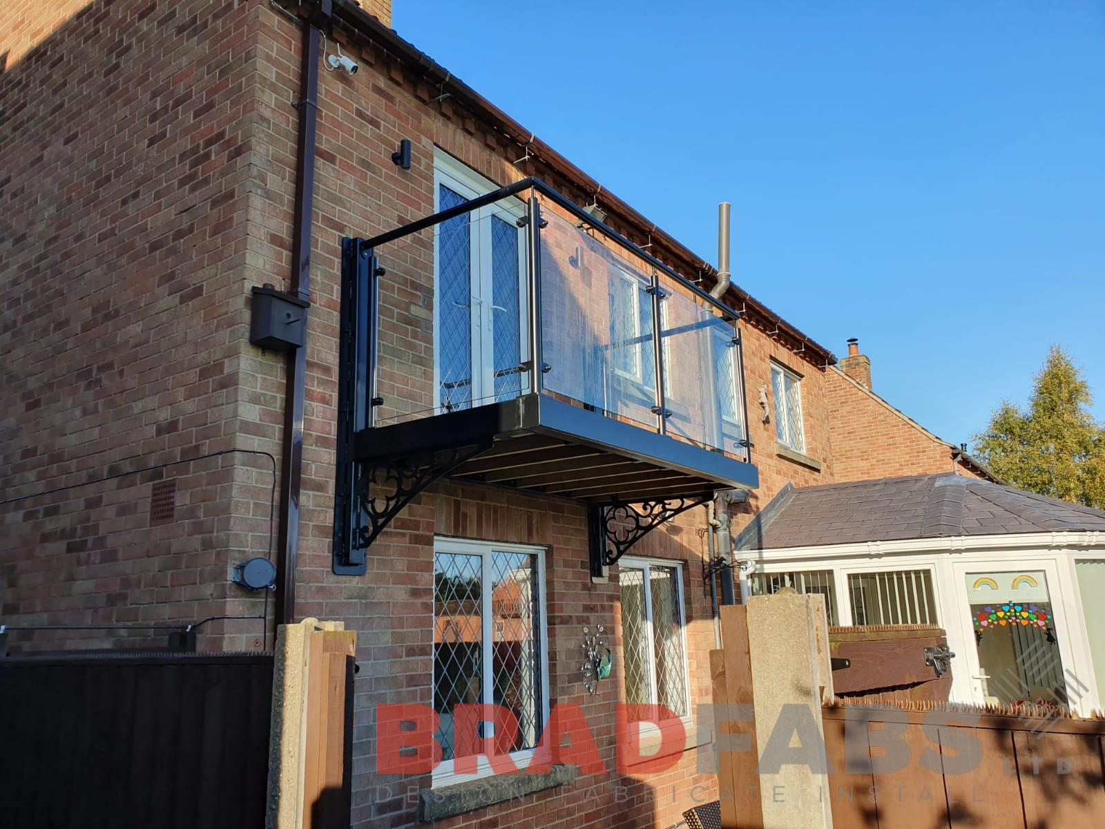Cantilevered balcony with decorative steelwork to support brackets by Bradfabs Ltd