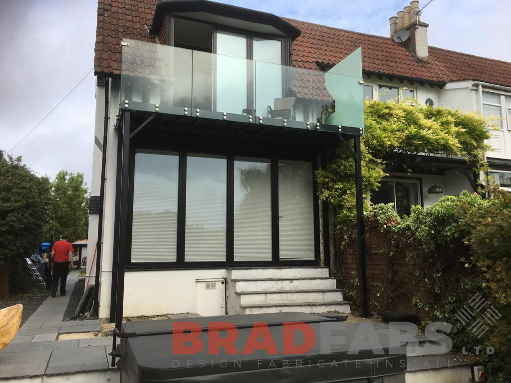 Balcony with bolt on infinity glass balustrade and privacy screen to one side by Bradfabs Ltd