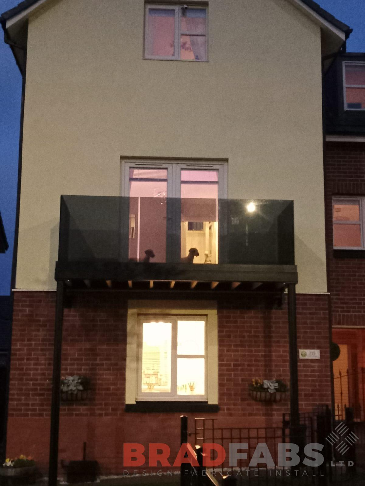 Bradfabs, tinted infinity glass channel system balustrade, bespoke balcony, steel balcony