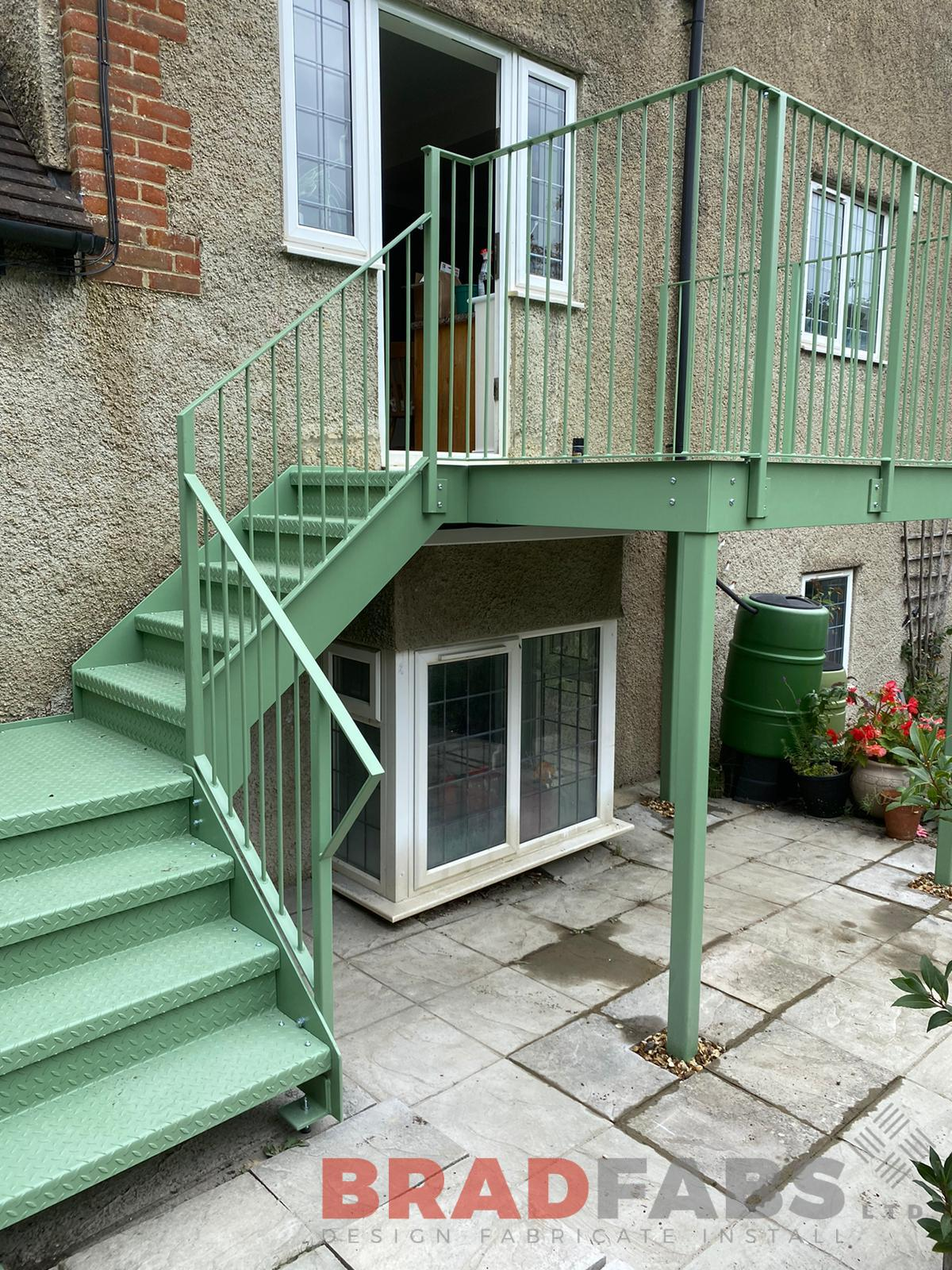 bespoke balcony and straight staircase by Bradfabs, mild steel, galvanised and powder coated with durbar treads and landings