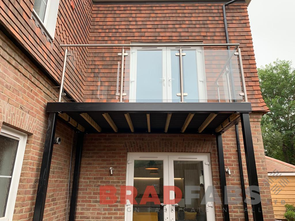 Bradfabs, stainless steel and glass balustrade, balcony with support legs, composite decked flooring, steel balcony