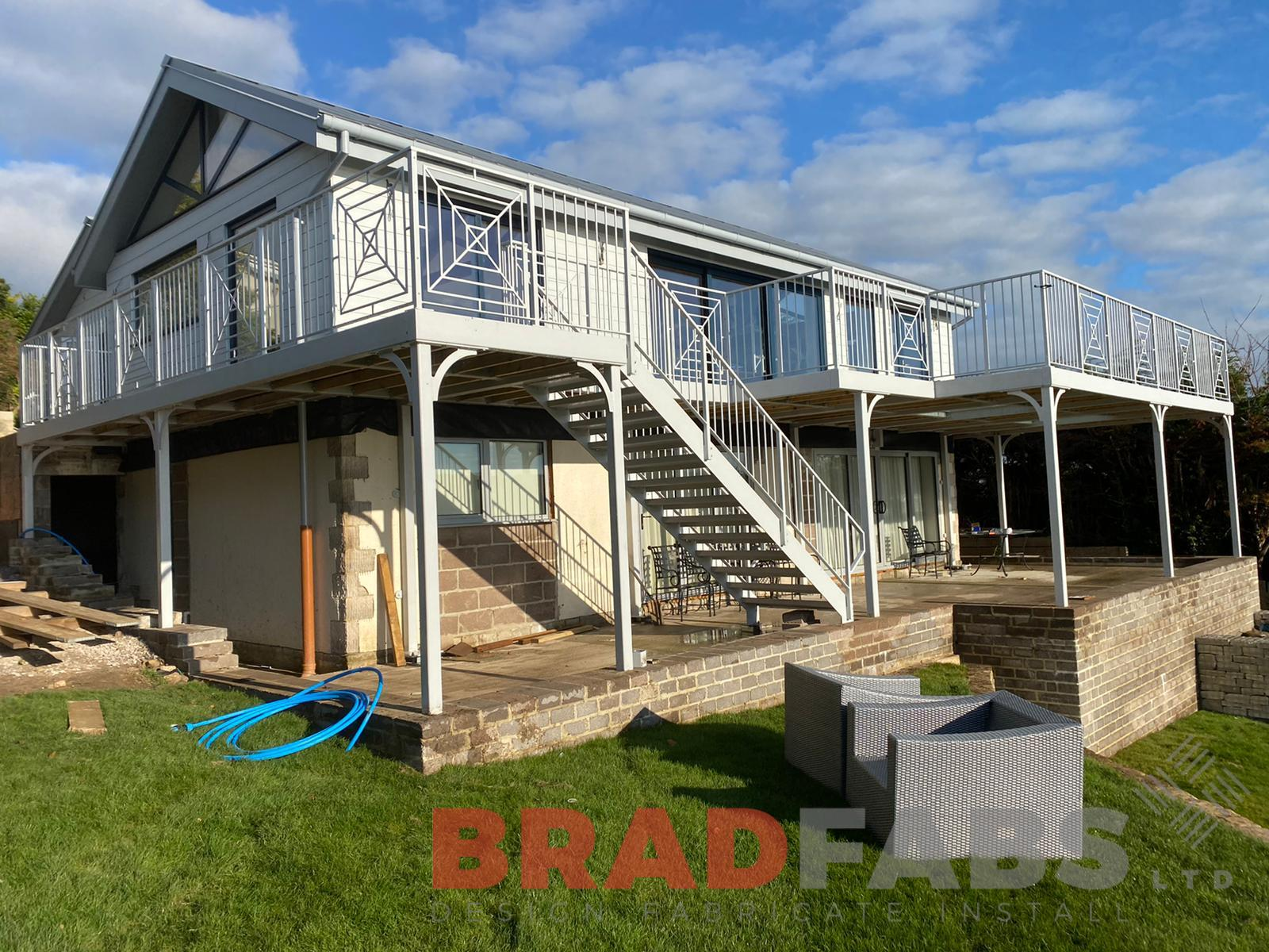 Bradfabs, large balcony, balcony with staircase, glass floor panels, mild steel balcony, composite decked flooring