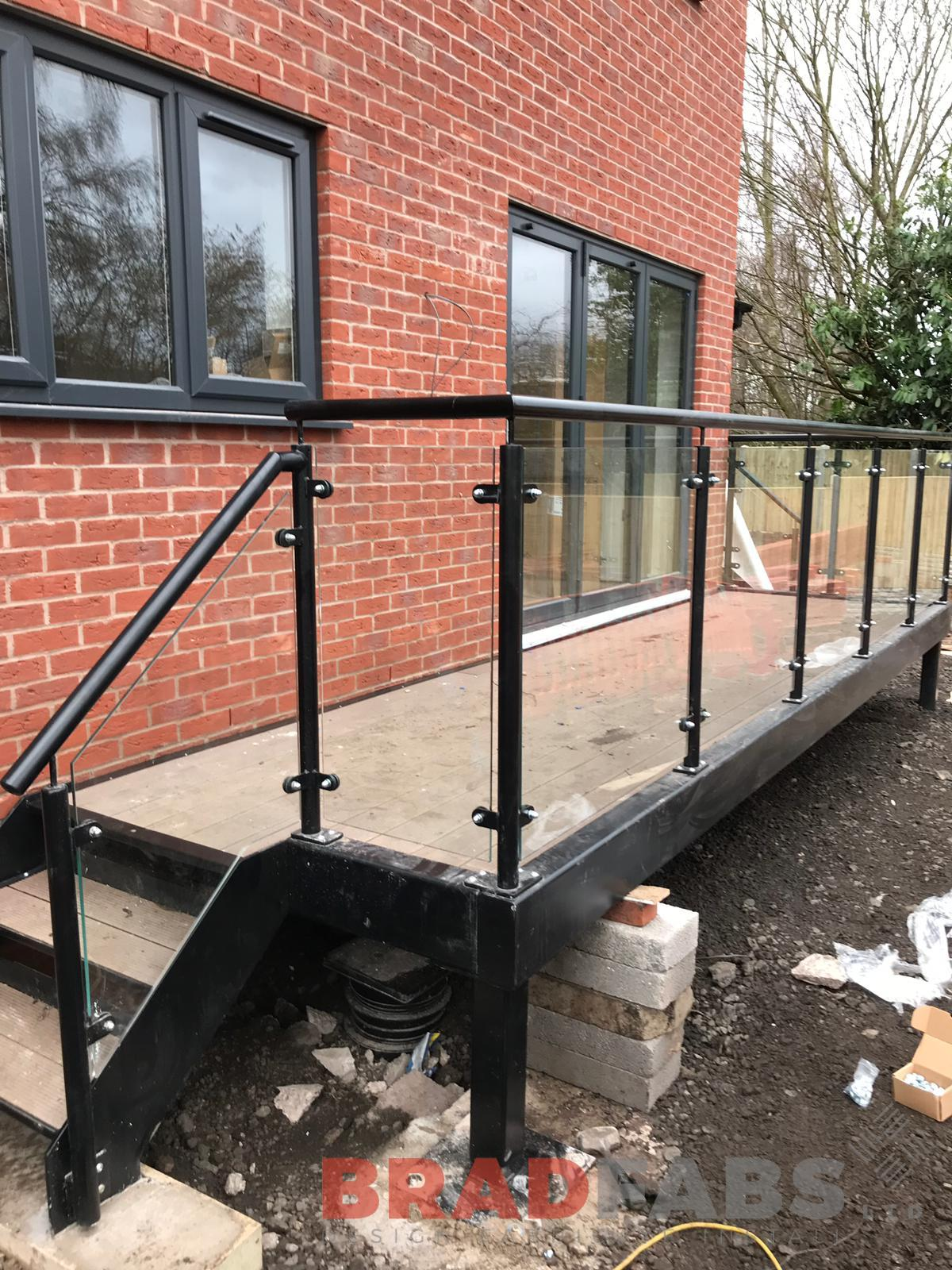 Steel Balcony with powder coated balustrade and staircase fabricated by Bradfabs, UK manufacturers