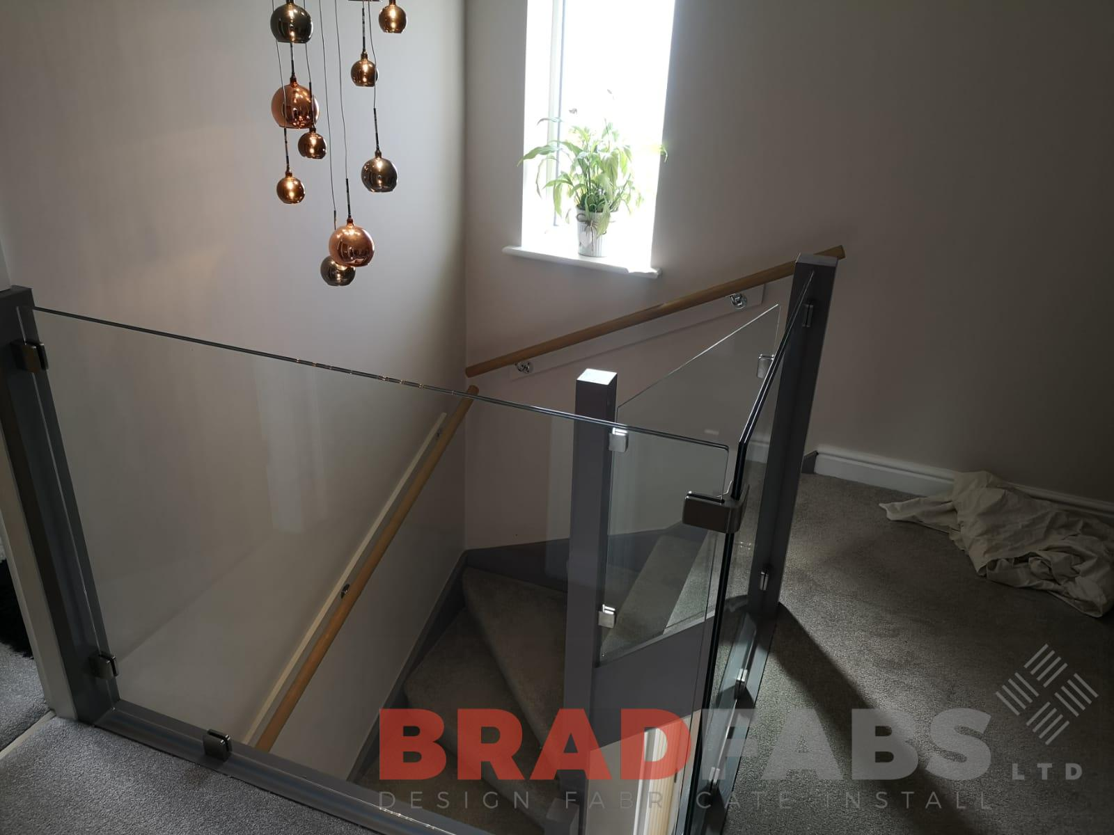 12mm toughened laminated safety infinity glass balustrade by Bradfabs