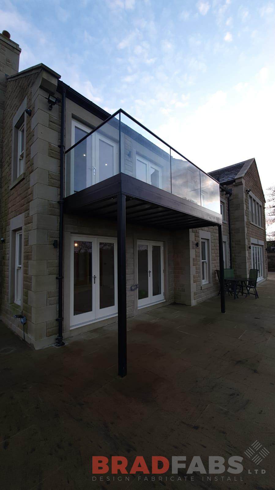 mild steel powder coated and galvanised toprail with glass balustrade by bradfabs ltd