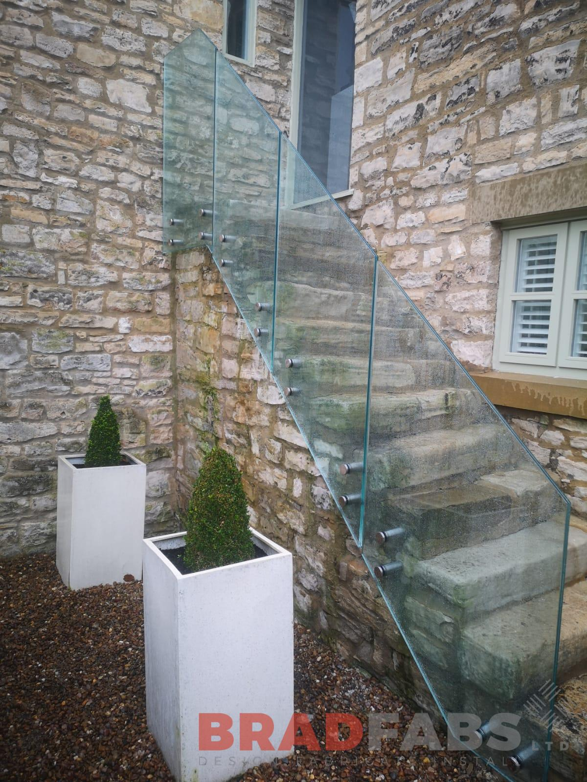 Bespoke laminated glass balustrade for our customers external stone stairs by Bradfabs