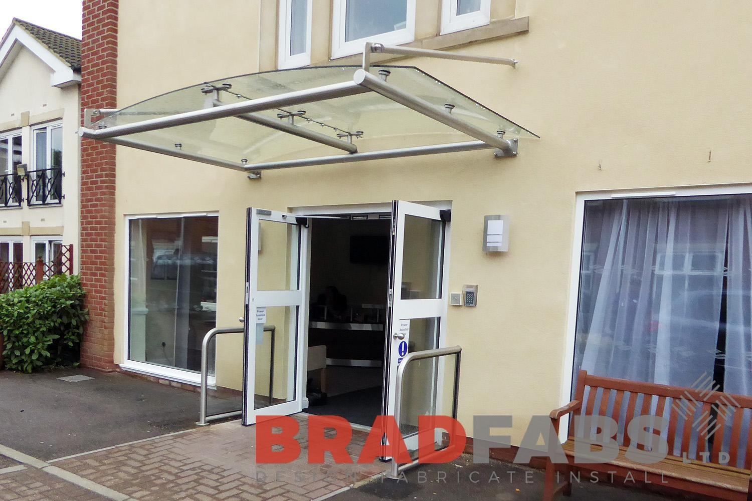 curved glass and steel panel canopy in an entrance installed for nursing home