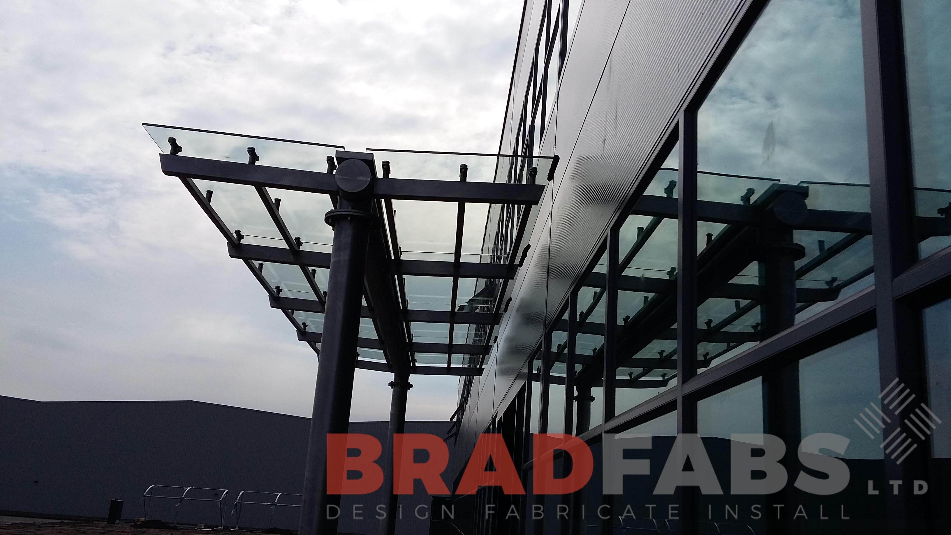 Large stainless steel and glass canopy designed and manufactured by Bradfabs