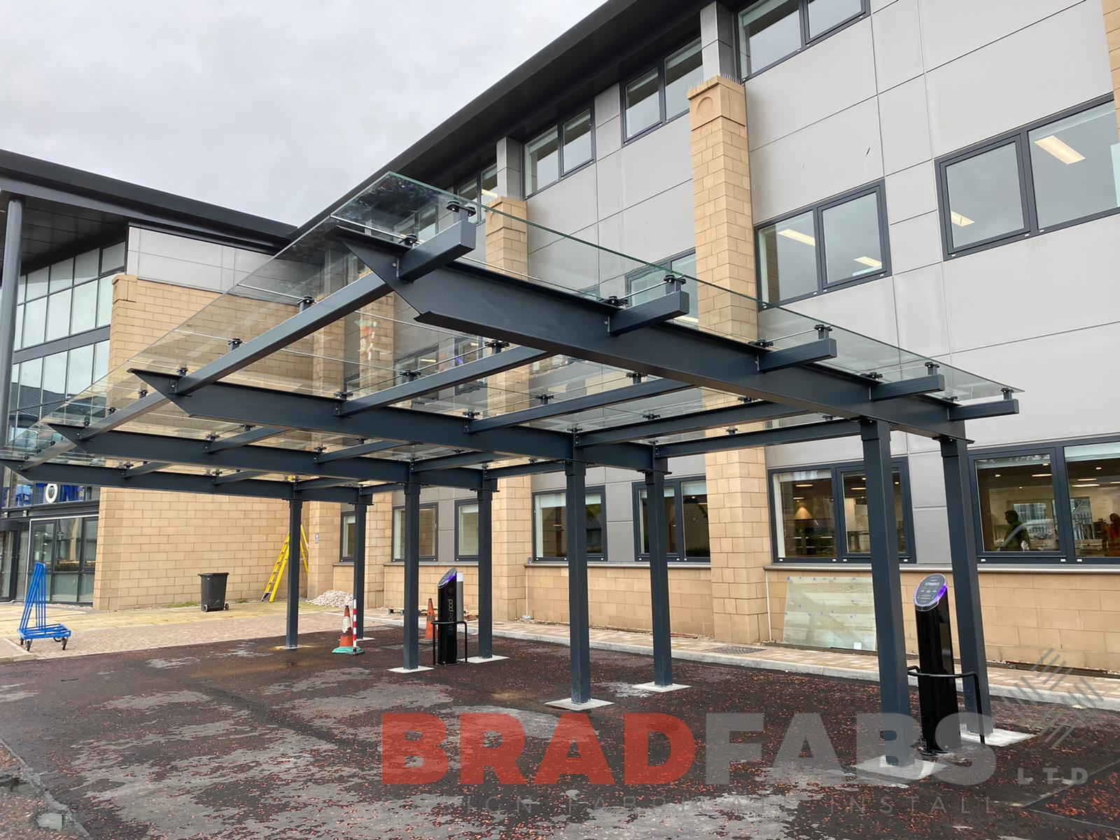 Large glass canopy for a commercial building by Bradfabs Ltd