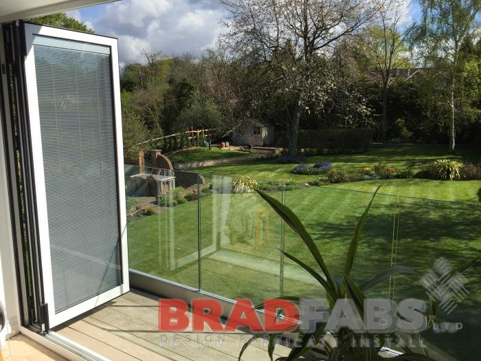 Our customer can now enjoy the view of their beautiful garden with infinity glass balustrade in a channel system balcony by Bradfabs