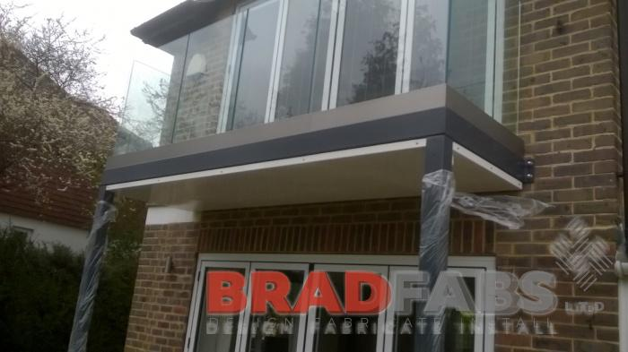 Another beautiful bespoke balcony by Bradfabs with infinity glass balustrade in a channel system